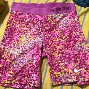 Nike Pro pink and yellow shorts